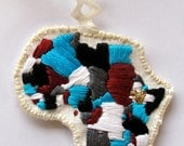 Africa embroidered ornament in blues maroon black and grays with gold heart over Ethiopia Christmas