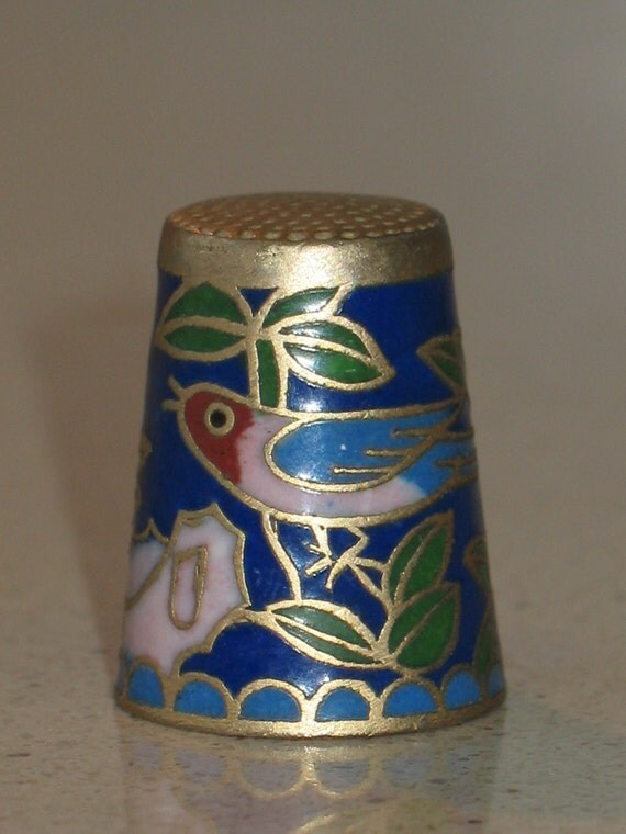 thimble, sewing collectibles, cloisonne  enameled dark blue decorated with a bird  flowers and leaves