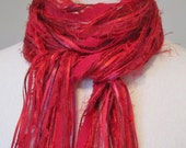 Upcycled scarf of silk fabric ribbon and specialty yarns in red & maroon