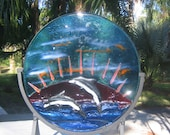 Dolphins at Ruby Cove - Two dolphins against a red sunset play in the warm ocean waters. Suncatcher original stained glass art sculpture