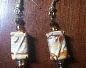 Dangle earrings with cream colored porcelain with gold accents