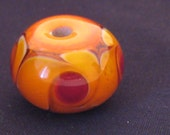Orange Pinwheel Floral Bead - one of a kind handmade lampwork glass
