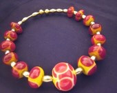 Red and Yellow with Silver Bracelet featuring unique handmade lampwork glass beads