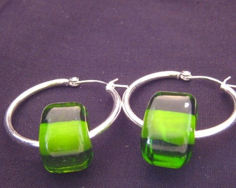 unique handmade lampwork glass earrings featuring transparent green beads