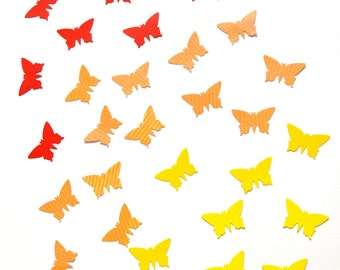Handpunched butterflies in the shades of yellow, orange and red - confetti