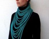 The padaung neckwarmer - handwoven in emerald jersey fabric