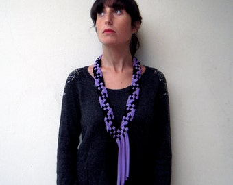 The handwoven necklace - handmade in black and lilac jersey fabric