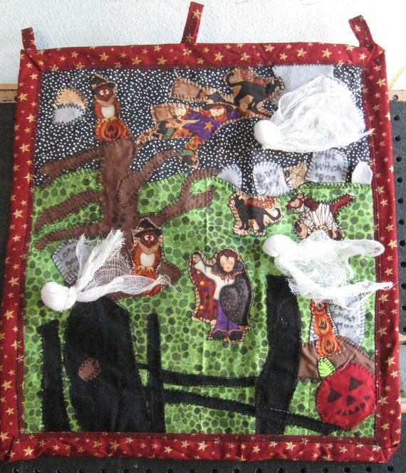 A Haunting We will go, a 24x29 wall hanging whacked out appliqued quilt