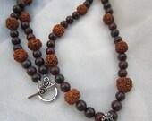 Goddess Tara rosary necklace of rudraksha seeds and brecciated jasper