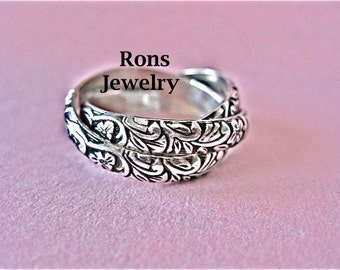 Sterling Silver, Fun, Rolling Puzzle Ring of Designed Flowers