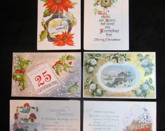 6 antique Christmas postcards, child with doll postcard, floral and scenic postcards, embossed postcards