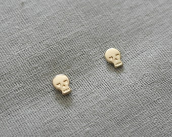 Make a wish gold plated tiny skull earrings