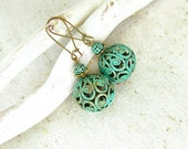Brass filigree earrings with green blue patina.