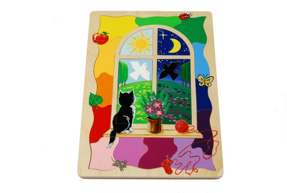 Wooden puzzle cat in the window (age 3- 4 )