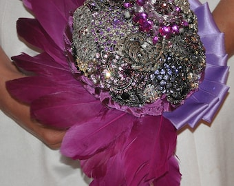 brooch bouquet with feathers and brooches in shades of magenta and lavender