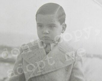 Little spanish gentleman with classic coat ant tie. Cute elegant child. Paper ephemera from Spain