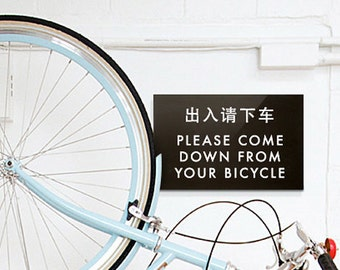 Funny Sign. Chinglish Bike Humor. Please Come Down from your Bicycle