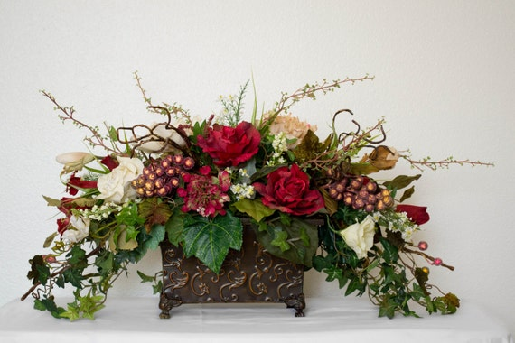 Medium silk floral arrangement with roses grapes and ivy