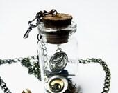 Glass vial pendant, steampunk clockwork parts.