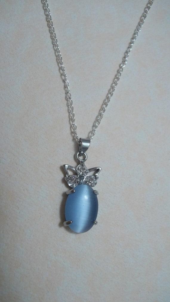 items similar to light blue cat s eye and topaz pendant