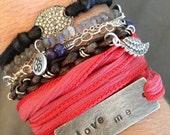 LOVE ME,  sterling oxidized silver bracelet on silk ribbon
