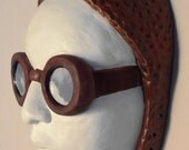 Aviator vintage style female face - white ceramic wall sculpture with mixed media collage.