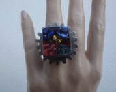 Resin ring with recycled coffee capsules and cog of old typewriter machine.