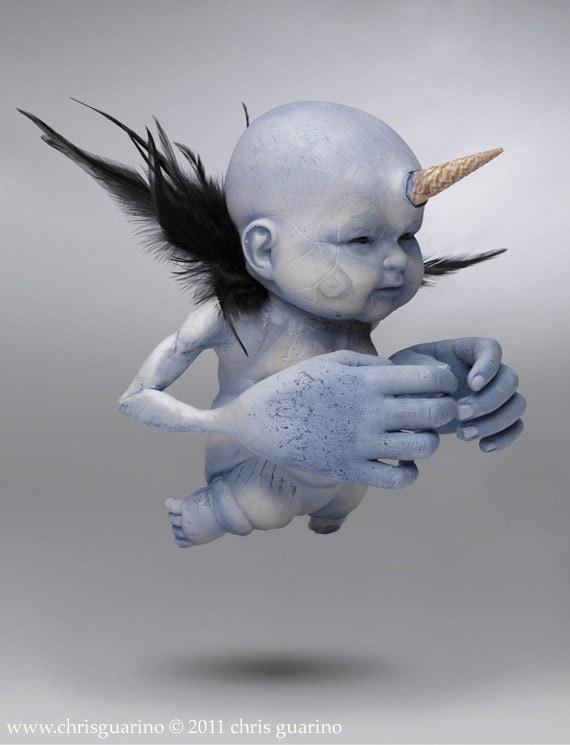 unicorn, blue baby, creepy, dark art, horns, feathers, big hands, tribal, sculpture photograph, cute creatures, baby doll, The Creepicorn