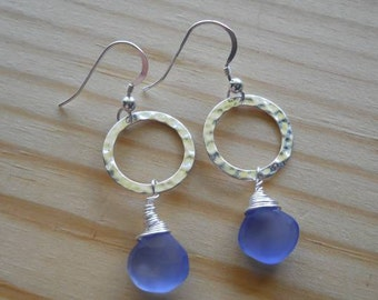 This listing is for a pair of  blue heart faceted chalcedony briolette earrings. They are wire wrapped in sterling silver...GORGEOUS.