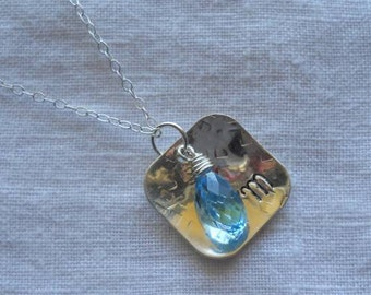 Hand stamped Sterling Silver necklace with a wire wrapped aqua blue swarovski tear-drop crystal briolette