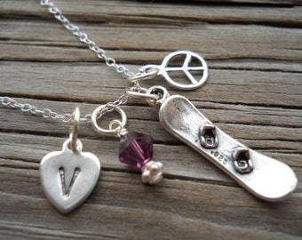 Snowboarding necklace/key chain.....Great necklace for your favorite snowboarder... hand stamped in sterling..