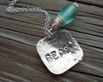 Beach lovers sterling silver necklace....  hand stamped, with a wire wrapped glass bead..... VERY BEACHY...