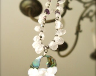 Lotus Necklace with crystals, stones, glass & metal beads and a mother of pearl, abalone decorated Pendant on silver.