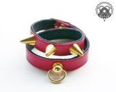 Red double tour studded leather bracelet with golden d-ring
