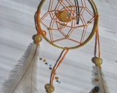 Dreamcatcher hand made with beads and feathers