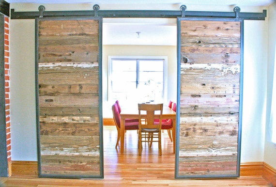 Barn doors in reclaimed wood tracks included by dancinggrains for Barnwood pocket door