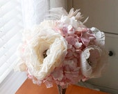 Soft fabric garden roses nestled into pale pink paper flowers, vintage broach centered flowers and ostrich feather bouquet