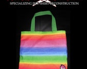 Color Explosion. A spunky bright rainbow colored purse with an adorable cupcake skull patch.