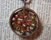 Glass beads pendant  - Beautiful glass beads encased in resin with open back copper bezel
