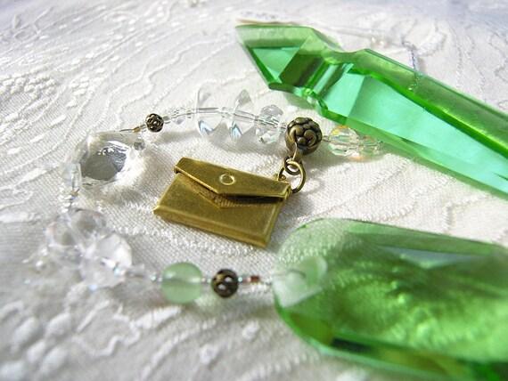 Depression glass green prism Suncatcher, rainbow maker, beaded sun catcher, envelope locket, Prosperity Chi-Swirler