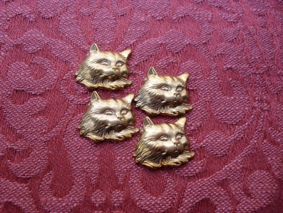 4  Vintage Red Brass Cat Head Stampings