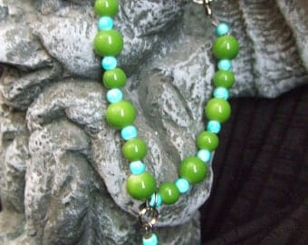 Green and Blue beaded bracelet with Green Howlite skull bead and silver toggle clasp