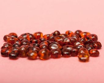 50 pcs of polished Baltic Amber loose beads.