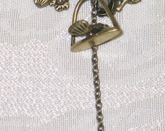 Antiqued brass bird and charm necklace