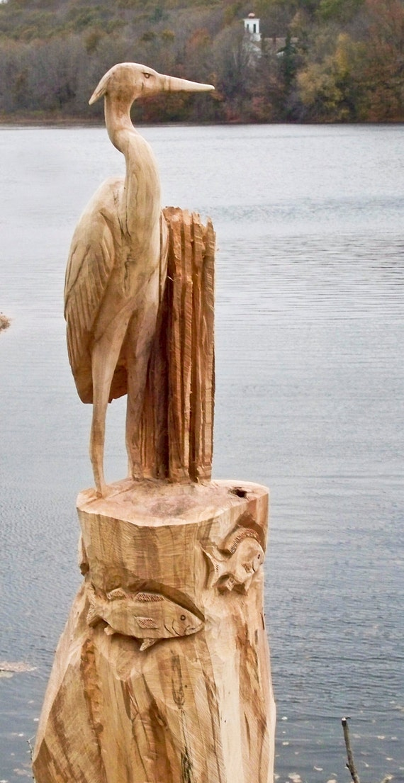 Items similar to blue heron with fish carving on etsy