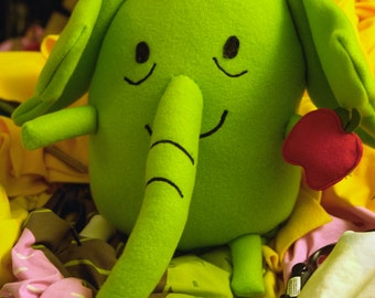 Tree Trunks the apple pie making elephant ! from TV show Adventure time Plush toy with red apple in hand. 12 x 11 inches & lime green.