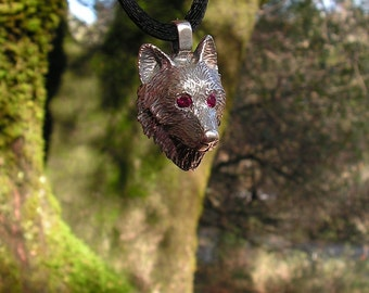 Sterling Silver Timber Wolf Pendant With Ruby Eyes