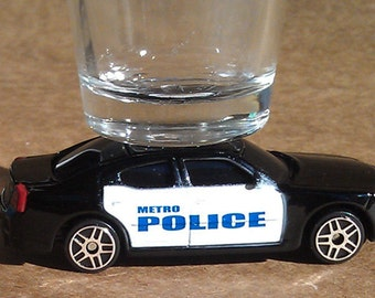 the ORIGINAL Hot Shots Shot Glass, '08 Dodge Charger Metro Police Car, B & W. Hot Wheels