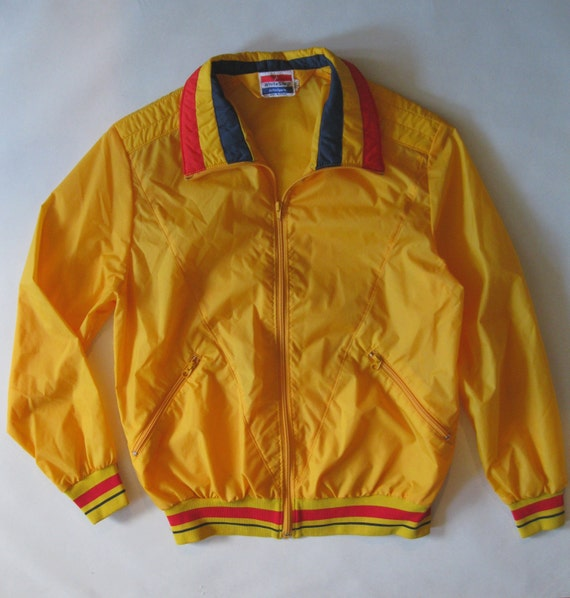 Yellow windbreaker jacket, with red and navy blue striped collar, cuffs, and waistband, 1970's small
