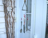 WINDCHIME of recycLed siLverWare and PoTaTo MasHer and red,orange  and whiTe glass beaDs